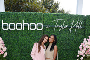 (L-R) Taylor Hill and Jasmine Tookes attend boohoo x Taylor Hill Tea Party at The Beverly Hills Hotel on October 13, 2019 in Beverly Hills, California.