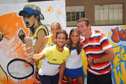 Feliciano Lopez of Spain, Elina Svitolina of Ukraine, Pat Cash of Australia and Monica Puig of Puerto Rico pose for a selfie after painting street art with Melbourne graffiti artist Daniel Wenn (unseen) during the ellesse Tennis Performance Apparel Launch on January 17, 2014 in Melbourne, Australia. The new range of tennis performance apparel will be worn by Feliciano Lopez, Elina Svitolina and Monica Puig at the Australian Open.
