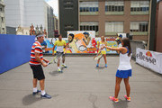 Feliciano Lopez of Spain, Elina Svitolina of Ukraine, Pat Cash of Australia and Monica Puig of Puerto Rico play a game of tennis on the rooftop after painting street art with Melbourne graffiti artist Daniel Wenn during the ellesse Tennis Performance Apparel Launch on January 17, 2014 in Melbourne, Australia. The new range of tennis performance apparel will be worn by Feliciano Lopez, Elina Svitolina and Monica Puig at the Australian Open.