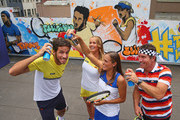 Feliciano Lopez of Spain, Elina Svitolina of Ukraine, Monica Puig of Puerto Rico and Pat Cash of Australia pose with cans of spray paint after painting street art with Melbourne graffiti artist Daniel Wenn (unseen) during the ellesse Tennis Performance Apparel Launch on January 17, 2014 in Melbourne, Australia. The new range of tennis performance apparel will be worn by Feliciano Lopez, Elina Svitolina and Monica Puig at the Australian Open.