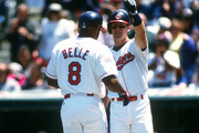 Jim Thome #25 greets Albert Belle #8 of the Cleveland Indians after Belle hit a home run in an MLB game at Jacobs Field in Cleveland, Ohio. Thome played for the Indians from 1991-2002. Belle played for the Indians from 1989-1996.