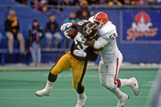Linebacker Mike Johnson #59 of the Cleveland Browns tackles running back Barry Foster #29 of the Pittsburgh Steelers during a game at Three Rivers Stadium on December 27, 1992 in Pittsburgh, Pennsylvania.  The Steelers defeated the Browns 23-13.