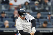 NEW YORK, NY - May 12:  Matt Holliday #17 of the New York Yankees breaks his bat as he hits the ball in an MLB baseball game against the Houston Astros on May 12, 2017 at Yankee Stadium in the Bronx borough of New York City. Astros won 5-1.