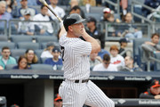 Matt Holliday #17 of the New York Yankees watches his home run as he follows through on the swing in the first inning in an MLB baseball game against the Baltimore Orioles on April 30, 2017 at Yankee Stadium in the Bronx borough of New York City. Baltimore won 7-4..