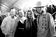Image has been shot in black and white.)  Musicians Tyler Hubbard (L) and Brian Kelley (R) of Florida Georgia Line with Brittney Marie Cole and Hayley Stommel attend the 2017 iHeartRadio Music Awards which broadcast live on Turner's TBS, TNT, and truTV at The Forum on March 5, 2017 in Inglewood, California.