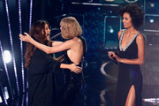 Recording artists Selena Gomez (L) and Taylor Swift hug onstage during the iHeartRadio Music Awards at The Forum on April 3, 2016 in Inglewood, California.