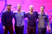 (L-R) Musicians Jonny Buckland, Chris Martin, Will Champion and Guy Berryman of the band Coldplay pose onstage at the iHeartRadio Music Festival held at the MGM Grand Garden Arena on September 23, 2011 in Las Vegas, Nevada.