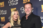 """Tori Spelling (L) and Dean McDermott attend WE tv celebrates the return of """"Love After Lockup"""" with panel, """"Real Love: Relationship Reality TV's Past, Present & Future,"""" at The Paley Center for Media on December 11, 2018 in Beverly Hills, California."""