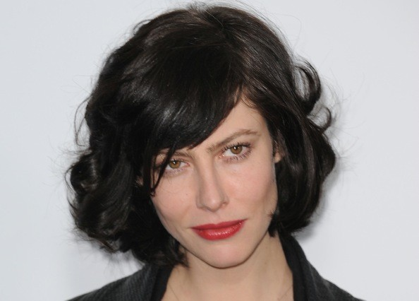 She is also a total knockout with a beautiful curly bob haircut.