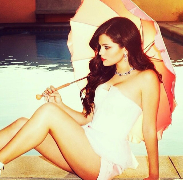 Selena Gomez lounges poolside.