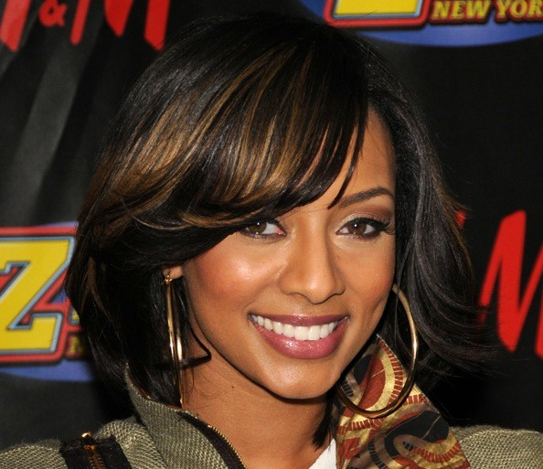 Keri sometimes wore this longer cut styled more casually, with gentle ...