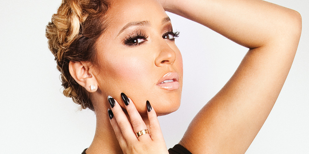 Adrienne Bailon, host of Oxygen's Nail'd It, strikes a pose.