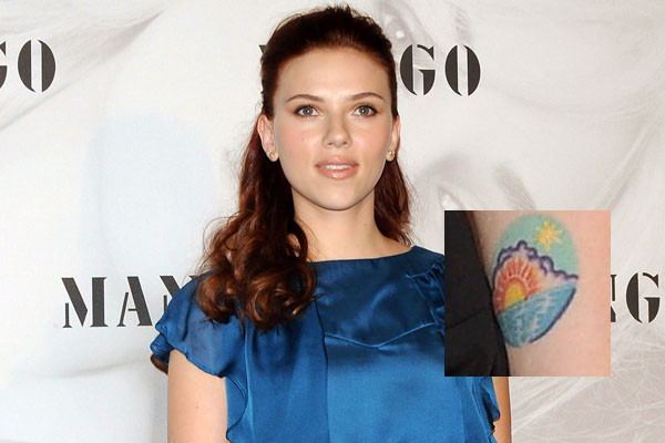 Scarlett Johansson Tattoos painted hers hand with sun and beach tattoos