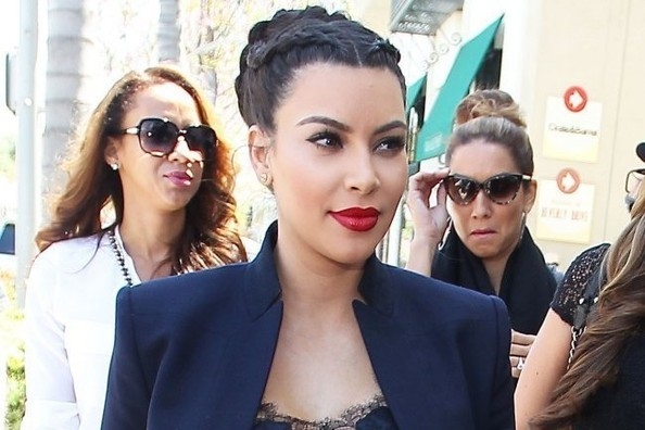 Kim Kardashian Shows Off Her Pregnant Belly in a Sheer Lace Camisole [PHOTOS]