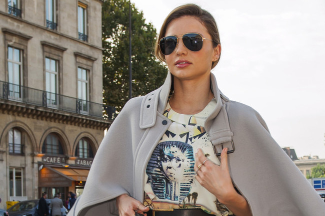 Miranda Kerr Takes On Paris in a Luxe Cape and Thigh-High Boots