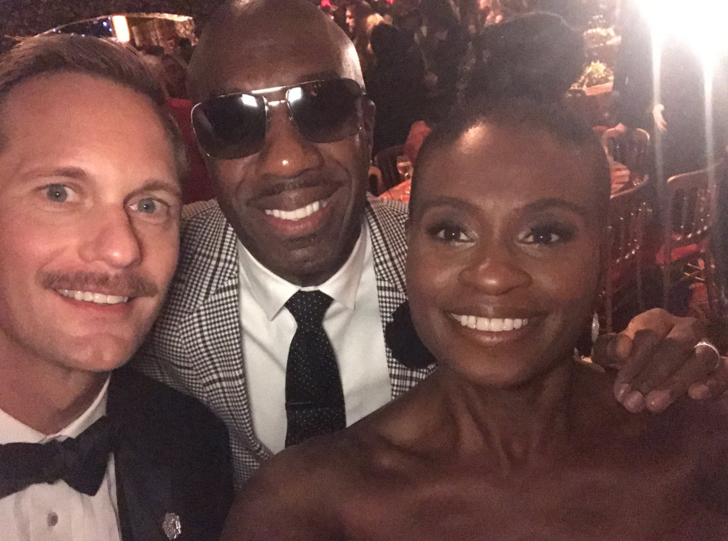 Adina Porter is seen with Alexander Skarsgård and J.B. Smoove at Emmys 2017