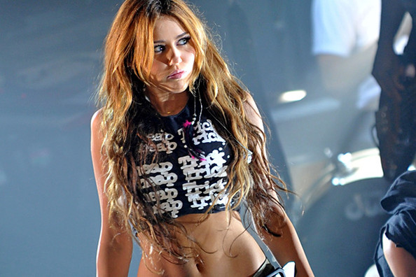 Miley Cyrus says that while she's grown into her sexy new image, ...