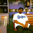 Ice Cube chills in the Dodgers dugout.