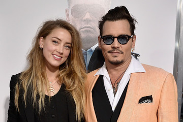 Johnny Depp and Amber Heard Have Reached a Settlement in Their Domestic Violence/Divorce Case