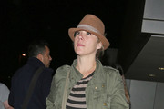 Actress Christina Applegate wearing a brown hat and green jacket seen at Lax airport