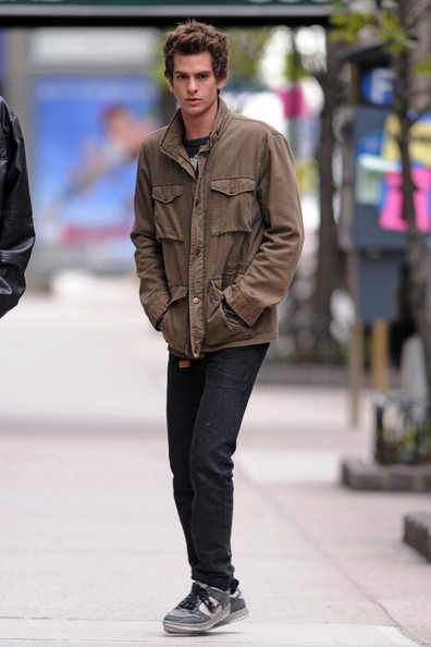 "Actor Andrew Garfield on set in New York filming ""The Amazing Spider-Man"". Andrew, who is playing ""Spider-Man"", looked relaxed between takes of the action film."