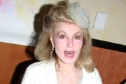 "Julie Newmar, who played Catwoman in the 1960's ""Batman"" TV Series, signs autographs at the Hollywood Collectors Show."