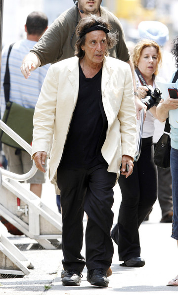 """Al Pacino, sporting a headband to keep his age-defying dark hair back, is seen heading back to his trailer in between takes on the set of HBO Film's """"Phil Spector"""". The film, to be directed David Mamet, will document the life of the record producer who created the """"wall of sound"""" but is now serving a 19-year prison sentence to life for shooting Lana Clarkson, a struggling actress, in 2003. Pacino, 71, is set to play Spector who produced numerous pop hits as well as mixing the final Beatles album, """"Let It Be."""