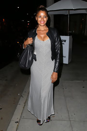 Claudia Jordan sported a black-and-white maxi dress for her look while out in Beverly Hills.