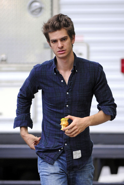 "Andrew Garfield snacks on an apple as he walks around the set of ""The Amazing Spiderman."