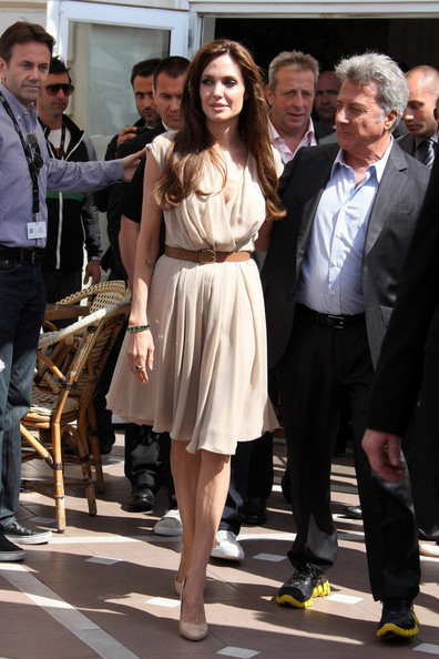 "Angelina Jolie and Dustin Hoffman at the  ""Kung Fu Panda 2"" photocall in Cannes. Angelina, who was looking very slim in a nude chiffon day dress, voices character ""Tigress"" in the film."
