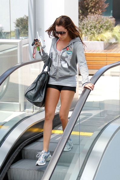 Ashley Tisdale Ashley Tisdale, wearing a tiny pair of spandex shorts and carrying some coconut water, leaves her local gym after a morning workout.