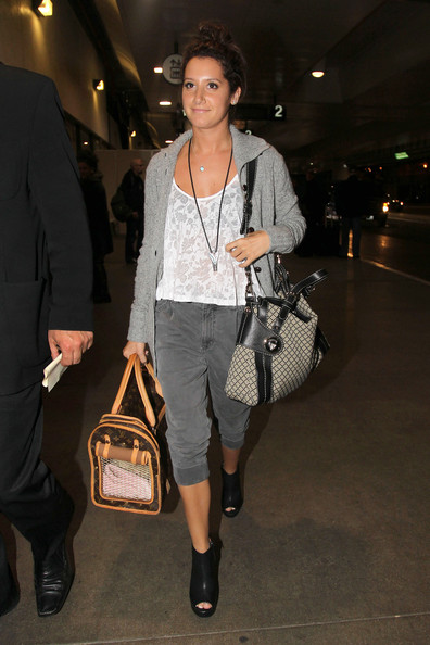 "Ashley Tisdale Ashley Tisdale keeps her dog safe in a Louis Vuitton dog carrier as she touches down at LAX Airport. Tisdale returned to Los Angeles after she had been filming her new hit show ""Hellcats"" in Vancouver."