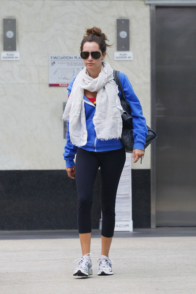 "Ashley Tisdale Ashley Tisdale, whose show ""Hellcats"" was recently canceled after one season, arrives at a local gym for an afternoon workout in LA. The rather thin looking ""High School Musical"" star showed off her slim figure in black leggings and a blue hooded sweatshirt worn with a scarf."