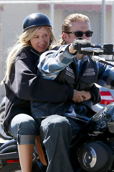 Ashley Tisdale holds onto Charlie Hunnam as they motor around the set of 'Sons of Anarchy' in LA