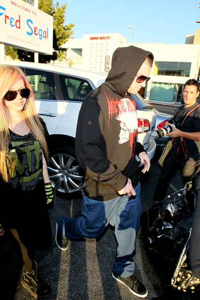 Avril Lavigne and boyfriend Brody Jenner exit the Fred Segal store in West