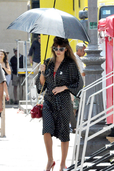 "Back to work! New mamma Penelope Cruz is all smiles as she arrives on the set of ""The Bop Decameron"" - Woody Allen's latest project. The Spanish Allen muse, who gave birth to her son Leo six months ago, showed of her womanly curves in a red Dolce and Gabbana dress as she shot her first scenes for the movie. In between takes, Penelope covered her voluptuous figure in a silk polka dot gown."