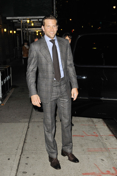 Actor Bradley Cooper stops for photos as he makes his way out of the 'Late Show With David Letterman' in New York City