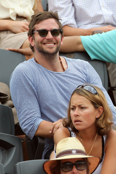 "Bradley Cooper and Lukas Haas take in a game during the French Open at the Stade Roland Garros. Coopers new film ""The Hangover: Part II"" has broken box office records in the last couple of weeks."