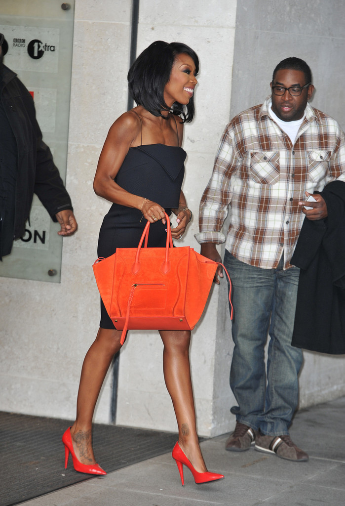 brandy in little black dress and celine bag