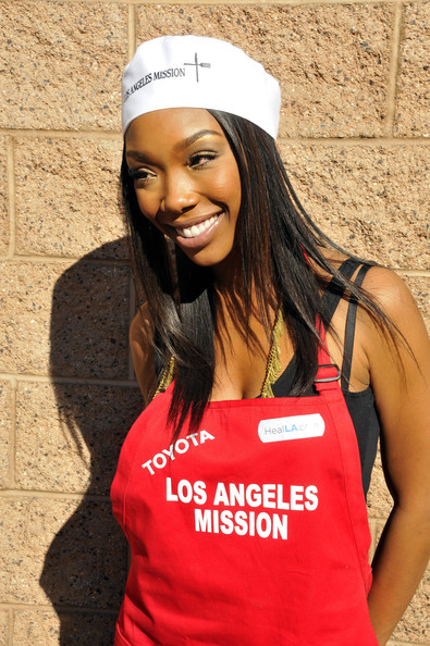 """Brandy """"Dancing With The Stars"""" Brandy Norwood lends a helping hand feeding thousands of homeless children at the Los Angeles Mission on Christmas Eve."""