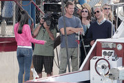 """The cast of """"Cougar Town"""" prepare to launch a boat off a dock in Marina Del Rey for a scene. The cast was spotted celebrating as the boat was successfully launched off the dock, only later to see it sink underwater."""