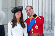 Prince William and Catherine Middleton, the Duke and Duchess of Cambridge, watch the Trooping the Colour parade from Buckingham Palace.