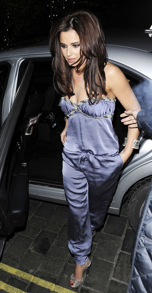 Cheryl Cole Wearing a grey, silk jumpsuit, Cheryl Cole arrives at Nobu restaurant in London to join her Girls Aloud bandmates for dinner. On the way in, Cheryl seemed unfazed when homeless men surrounded her..