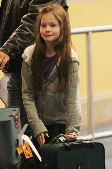 "Child star Mackenzie Foy arrives in Vancouver to film the latest installment of ""The Twilight Saga: Breaking Dawn - Part 2"". Mackenzie, 10, is seen posing for pictures and signing a fan's copy of the book."