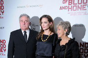 "Angelina Jolie with Brad Pitt's parents Bill Pitt and Jane Pitt at the ""In The Land Of Blood and Honey"" premier at the New York School Of Visual Arts in New York City."