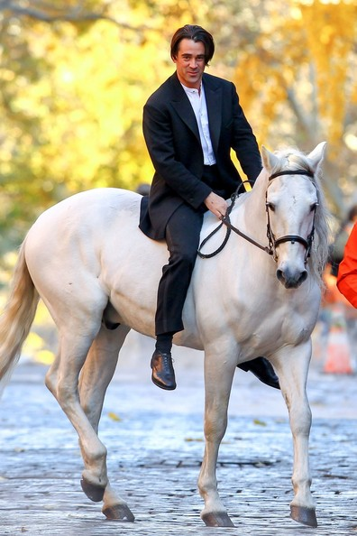 Colin Farrell is seen riding a white horse on the set ... |Ride The White Horse