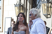 Elisabetta Gregoraci and Flavio Briatore leave their hotel to attend the lavish wedding of heiress Petra Ecclestone to James Stunt at the Castello Odeschalchi di Bracciano - the same venue where Tom Cruise married Katie Homes. Eric Clapton and the Black Eyed Peas entertained the guests following the happy couple's union.