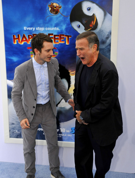 """Elijah Wood Elijah Wood joking around with Robin Williams at the premiere of """"Happy Feet Two"""" at the """"Grauman's Chinese Theatre""""."""
