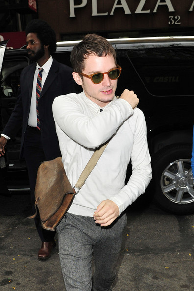 """Elijah Wood A stylish Elijah Wood signs autographs outside of the """"Today"""" show in NYC.  Wood has been promoting the movie """" Happy Feet 2"""" which he appears along side of Brad Pitt and Matt Damon."""
