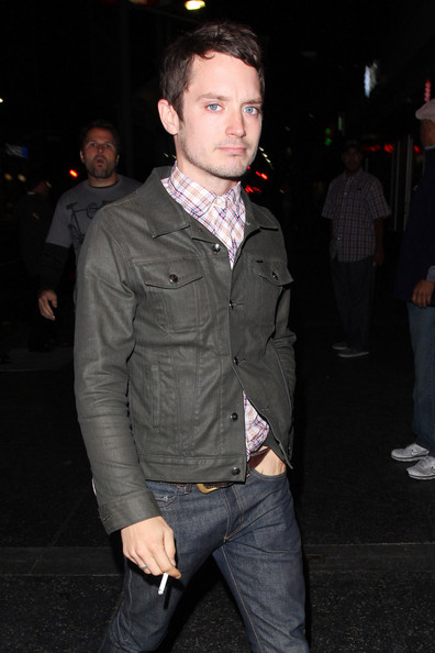 """Elijah Wood LORD OF THE SMOKE RINGS?  Elijah Wood has a quick smoke before the Smashing Pumpkins concert at The Wiltern. The """"Hobbit"""" actor almost tripped over his friend as he bent down infront of him to pick something off the ground."""